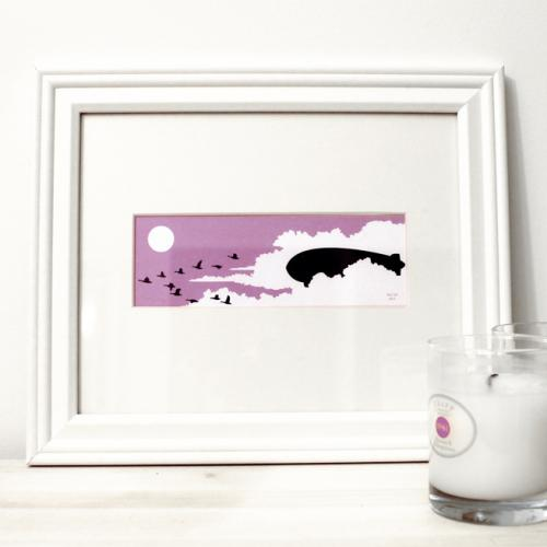 Pink flying birds and blimp framed art print for sale by Ricky Colson